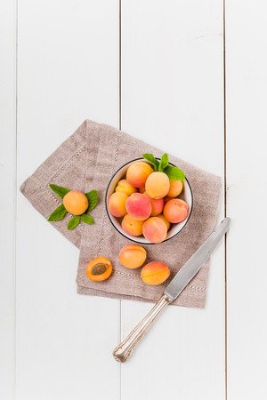 pip: Apricots in a bowl with mint