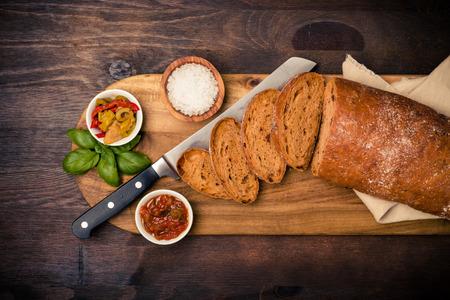 ciabatta: A loaf of ciabatta with antipasti and basil