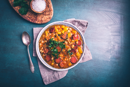 Stew with cabanossi peppers, onions and beans
