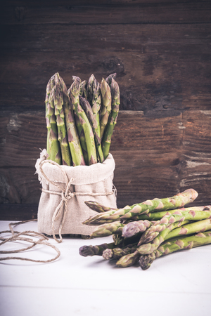 Fresh Green asparagus in a bunch and lots on a background Stock Photo