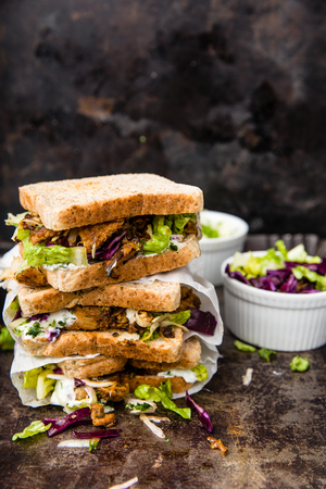 delicious gyros sandwich in paper bag with salad and tzatziki Stock Photo