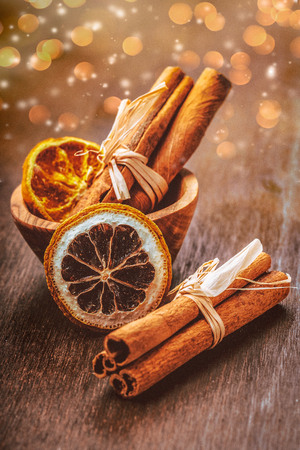 Cinnamon sticks with decoration on a wooden surface Stock Photo