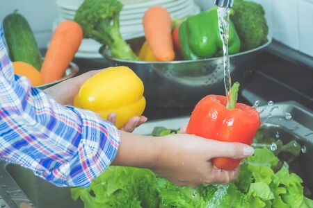 Washing fruit and vegetables to remove pesticides.