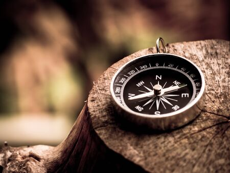 Compass on the wooden background in journey.