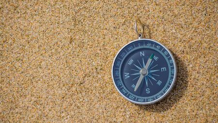 Navigational Compass On Sandy Beach with copy space. Stok Fotoğraf - 139063464