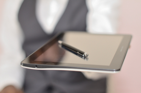 a man holds an electronic tablet in his hand