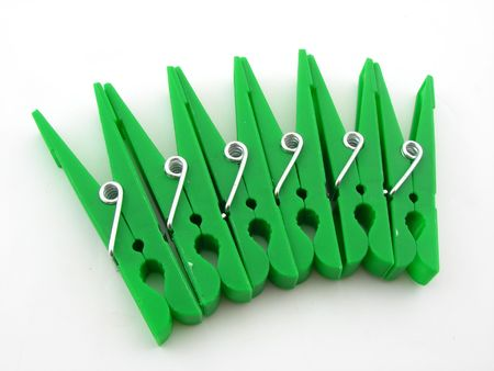 clothespegs: Green clothes-pegs isolated over white Stock Photo
