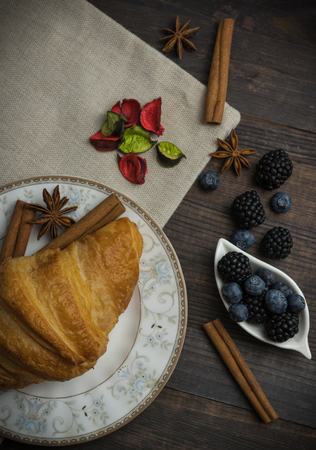 Breakfast with croissants, leaves. Flat lay, top view