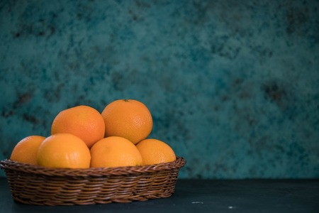 Fresh juicy clementines tangerines in a basket. fruits in winter. Stock Photo