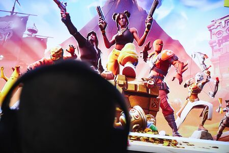 San Francisco, CA USA - April 2019: hand holding a phone with a Fortnite game logo close up.