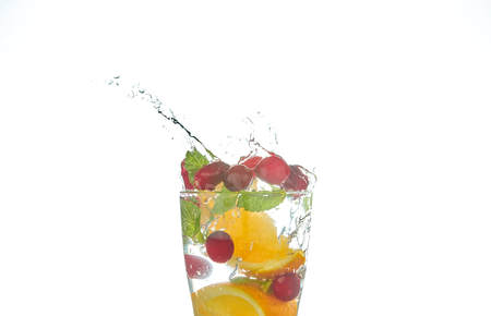 Summer refreshing cocktails with citrus and mint. orange and grapefruit segments. drink on a black table with ice cubes.