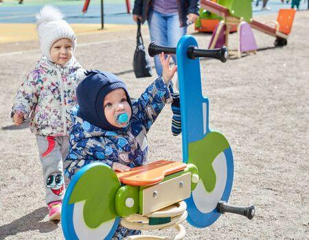 Small children play on the playground. child development. childrens games. entertainment for children.