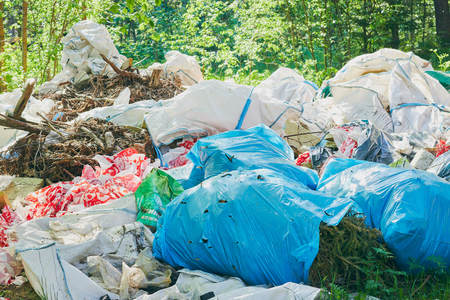 a pile of trash in the forest. breed protection. Plastic trash. The concept of environmental problems