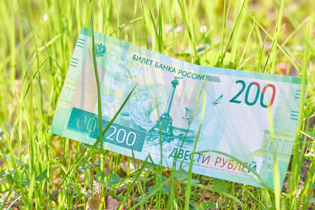New Russian Banknote Two hundred rubles. Cash paper green money. Boke background