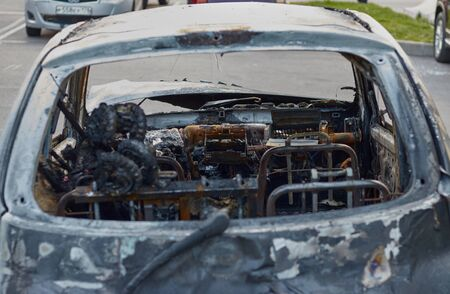 partially burned down car after the fire, parts of body the burned handles of doors and the burst glasses, picture not from pleasant, the insured car after the fire Stockfoto