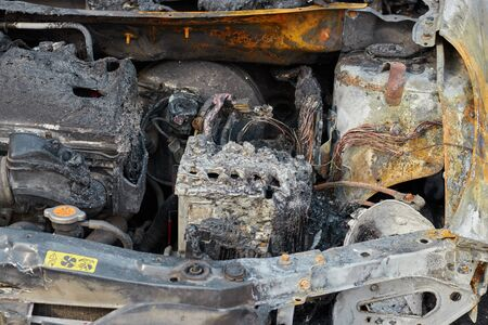 partially burned down car after the fire, parts of body the burned handles of doors and the burst glasses, picture not from pleasant, the insured car after the fire Banco de Imagens