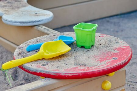 Colorful toys for childrens sandboxes on the sea beach