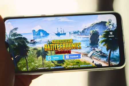 Los Angeles, California, USA - 17 December 2018: Hands holding a smartphone with PUBG FPS game