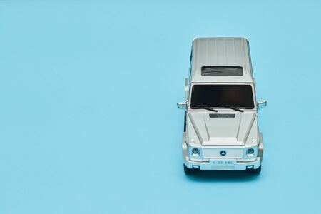 silver male toy car on a blue background. copy space, february 14 for valentines day, mock up for holiday Reklamní fotografie