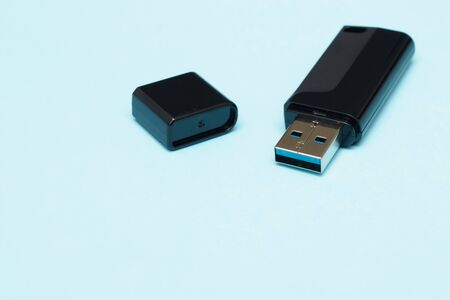 isolate flash drive on a blue background. electronics concept. memory for transferring files and information. flash card.