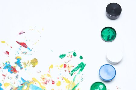Finger paints. background for advertising from children's finger paint. Copy space. Stock Photo