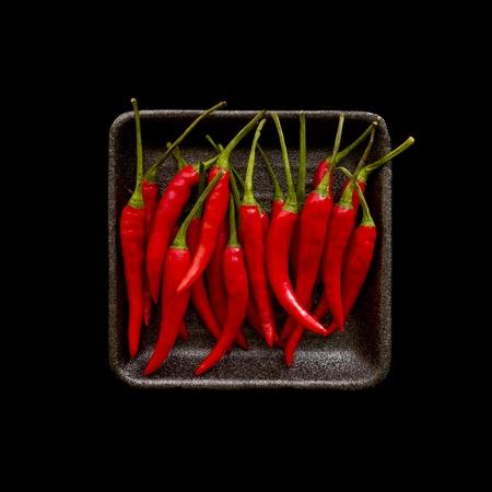 pimientos: Chiles aislados en negro Foto de archivo