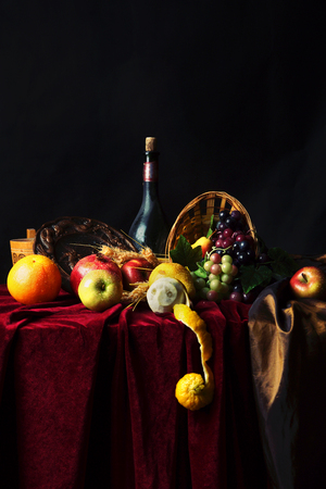 dutch: Classic Dutch still life with dusty bottle of wine and fruit on a dark background.