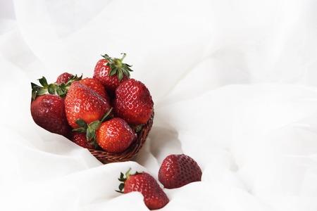 Berries of bright juicy strawberries in white milk or cream. Stock Photo