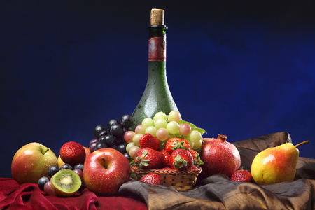 iron curtain: Classic Dutch still life with dusty bottle of wine and fruits on a dark blue background, horizontal. Stock Photo