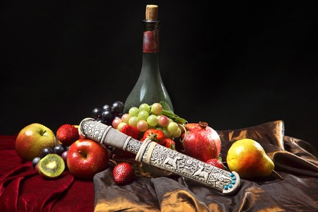 iron curtain: Old dagger in the scabbard, classic Dutch still life with dusty bottle of wine and fruits on a dark blue background,