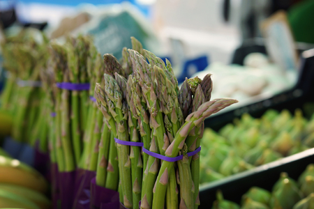 sell: Bunches of asparagus on the counter in the vegetable market in Spain. Stock Photo