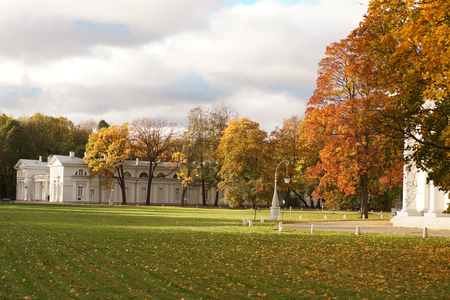Autumn landscape in the park with beautiful lanterns, classical zdonia and a well-groomed lawn