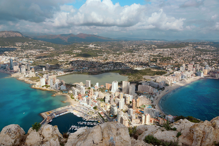 View from the mountain Ifach in Spain on the outskirts of Costa Blanca, the sea surrounds the peninsula, the city of Kalp lies at the bottom with tall houses and beaches Stok Fotoğraf