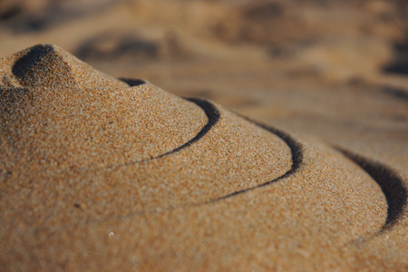 Sand mountain with wavy pattern, soft focus Stock Photo