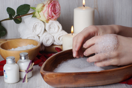 Preparing for a spa treatment for the skin, washing your hands in warm soapy water.