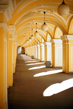 A lot of arches are yellow, a receding perspective.