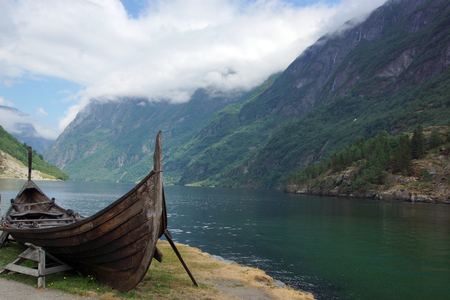 Viking ship on the shore of the fjord in Norway