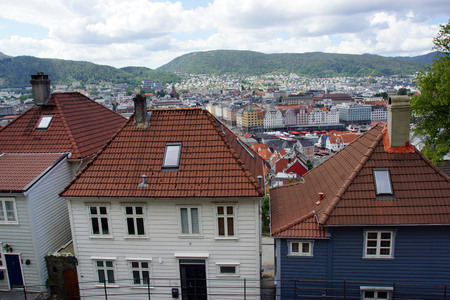 Houses made of wood with tile roofs in the city of Bergen in Norway.