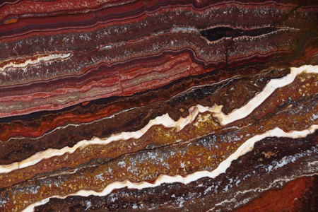 The structure of Onyx, a bright red color with dark streaks and waves, is called Onyx Fantastico.