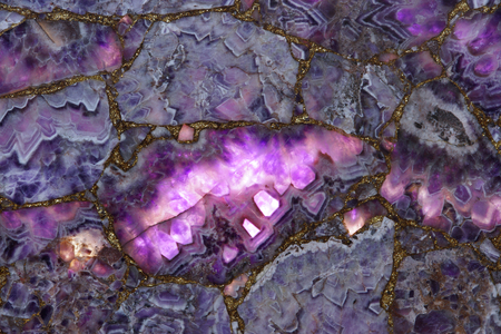 The light passes through a purple amethyst natural stone slab and beautifully highlights it in some parts