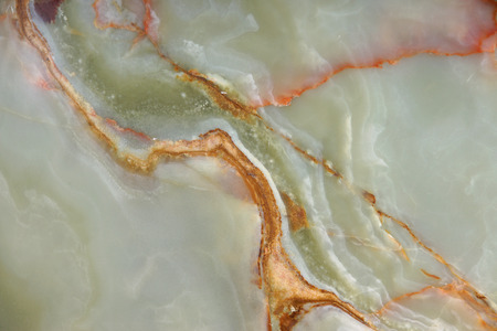 Background from a pattern of a natural stone of green onyx with red streaks.