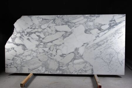 A large slab of natural white stone with gray veins is called marble Arabescato Corchia.