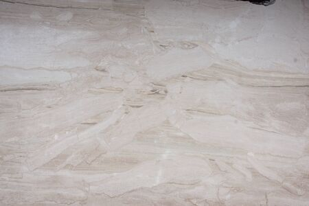 Beautiful background of natural stone in beige, with stains and spots called marble Breccia Sarda.