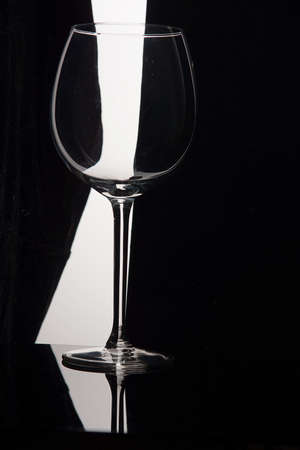 Empty wine glass on a black and white background.
