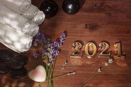 Hot massage stones, bian stone, lavender sprigs and golden numbers 2021