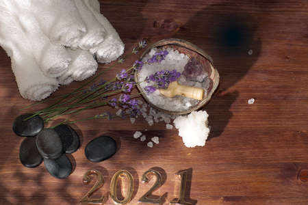 Basalt stones for hot massage and spa set with lavender next to gold numbers 2021 Imagens