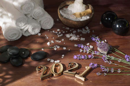 Lavender sprigs for aromatherapy and spa set next to 2021 numbers in golden metal Imagens