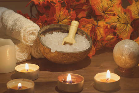 Spa composition with autumn leaves and burning candles