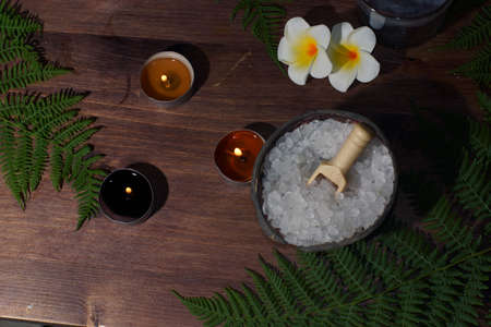 Spa treatments with bath salt burning candles and plumeria flowers Imagens