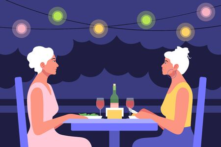 Two older women sitting at the table in profile. Date and business meeting in a cafe. Summer evening in a restaurant.